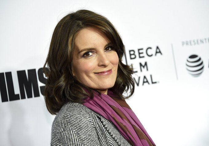 """FILE - In this April 18, 2018 file photo, Tina Fey attends the Tribeca Film Festival world premiere of """"Love, Gilda"""" in New York. The cast of """"30 Rock,"""" including Fey, Alec Baldwin and Tracy Morgan, will reunite to promote NBCUniversal shows for the 2020-21 season. The hour-long event will air July 16 on the NBC network and also be shown on NBCUniversal cable channels including Bravo and USA Network. (Photo by Evan Agostini/Invision/AP, File)"""