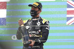 Third place Renault driver Daniel Ricciardo of Australia celebrates on the podium after the Eifel Formula One Grand Prix at the Nuerburgring racetrack in Nuerburg, Germany, Sunday, Oct. 11, 2020. (AP Photo/Matthias Schrader, Pool)