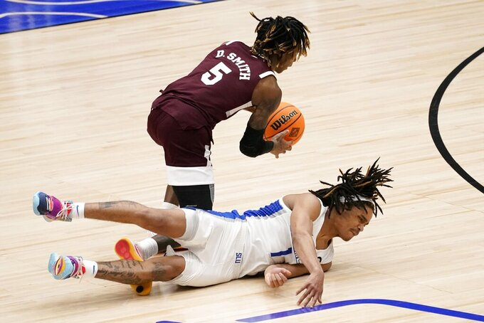 Mississippi State guard Deivon Smith (5) reaches a loose ball ahead of a diving Saint Louis guard Yuri Collins (1) during the second half of an NCAA college basketball game in the first round of the NIT Tournament, Saturday, March 20, 2021, in Frisco, Texas. (AP Photo/Tony Gutierrez)