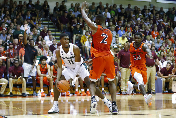 Michigan State forward Aaron Henry (11) tries to get around Virginia Tech guard Landers Nolley II (2) during the first half of an NCAA college basketball game Monday, Nov. 25, 2019, in Lahaina, Hawaii. (AP Photo/Marco Garcia)