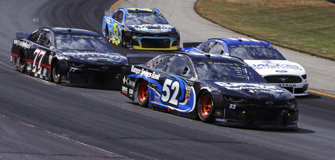 Austin Theriault (52) goes into Turn 1 with traffic during a NASCAR Cup Series auto race at New Hampshire Motor Speedway in Loudon, N.H., Sunday, July 21, 2019. (AP Photo/Charles Krupa)
