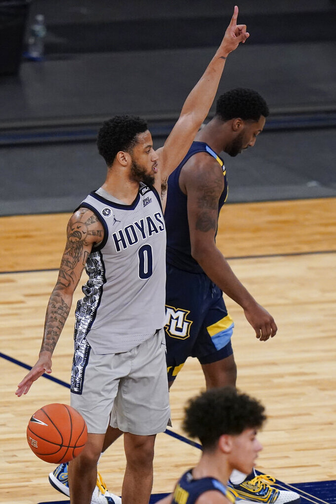 Georgetown's Jahvon Blair, left, gestures as Marquette's Symir Torrence, right, leaves the court after an NCAA college basketball game in the Big East conference tournament Wednesday, March 10, 2021, in New York. Georgetown won 68-49. (AP Photo/Frank Franklin II)