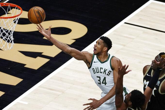 Milwaukee Bucks forward Giannis Antetokounmpo (34) releases a shot against the Atlanta Hawks during the first half of an NBA basketball game Thursday, April 15, 2021, in Atlanta. (AP Photo/John Bazemore)