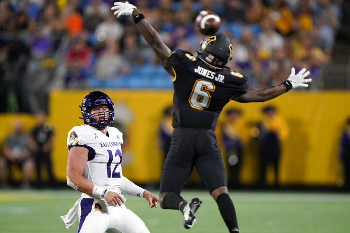Appalachian State defensive back Steven Jones Jr. blocks a pass from East Carolina quarterback Holton Ahlers during the first half of an NCAA college football game Thursday, Sept. 2, 2021, in Charlotte, N.C. (AP Photo/Chris Carlson)