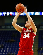 Wisconsin's Brad Davison (34) sinks a three point shot against Penn State during first half action of an NCAA college basketball game in State College, Pa. Sunday, Jan. 6, 2019. (AP Photo/Chris Knight)
