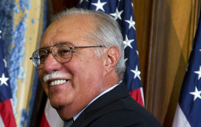 FILE - In this Jan. 3, 2013, file photo, U.S. Rep. Ed Pastor of Arizona is seen on Capitol Hill in Washington. Former U.S. Rep. Pastor, Arizona's first Hispanic member of Congress, will be laid to rest Friday, Dec. 7, 2018. Pastor, a liberal Democrat known for his bipartisanship, died at age 75 after suffering a heart attack last week.  (AP Photo/Evan Vucci, File)