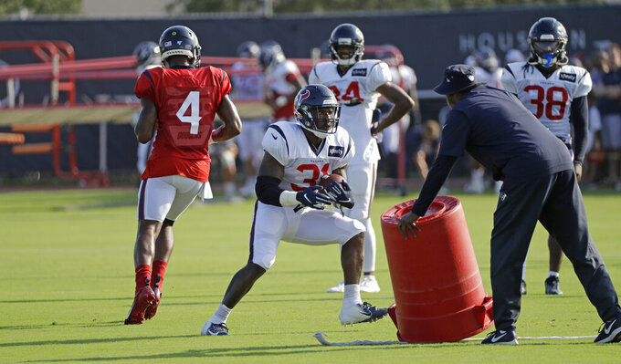 FILE - In this Thursday, Aug. 15, 2019 file photo, Houston Texans running back Karan Higdon (31) carries the ball during a joint NFL training camp football practice with the Detroit Lions in Houston.  The NFL still plans to hold training camps on time beginning in late July, though contingency plans are in place. Hours after the league canceled the Hall of Fame game that kicks off the preseason, the 32 team owners on Thursday, June 25, 2020 were updated on a variety of issues, many dealing with working through the coronavirus pandemic. (AP Photo/David J. Phillip, File)