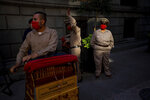 Organ grinders who make money from tips wait for donated groceries in Mexico City, Thursday, June 4, 2020. CADENA, a non-profit, civil organization dedicated to assisting during emergencies and disasters around the world, delivered groceries to hundreds of organ grinders who have lost their source of income amid restrictions to curb the new coronavirus. (AP Photo/Fernando Llano)