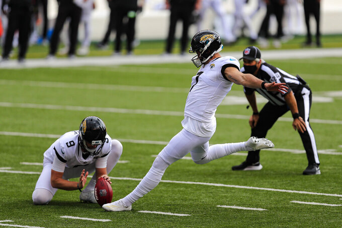 Jacksonville Jaguars kicker Stephen Hauschka (3) kicks a field goal from the hold of Logan Cooke in the first half of an NFL football game against the Cincinnati Bengals in Cincinnati, Sunday, Oct. 4, 2020. (AP Photo/Aaron Doster)