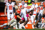 Syracuse receiver Sharod Johnson (19) is tackled by Clemson linebacker Baylon Spector (10) during an NCAA college football game in Clemson, S.C., on Saturday, Oct. 24, 2020. (Ken Ruinard/Pool Photo via AP)