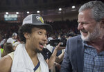 Liberty guard Darius McGhee, left, talks with Liberty University President Jerry Falwell Jr. after defeating Lipscomb in the Atlantic Sun Conference NCAA basketball championship game in Lynchburg, Va., Sunday, March 8, 2020. (AP Photo/Lee Luther Jr.)