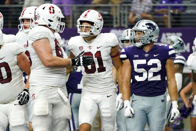 Stanford wide receiver Brycen Tremayne (81) celebrates his touchdown catch with teammates as Kansas State linebacker Nick Allen (52) looks on in the second half of an NCAA college football game in Arlington, Texas, Saturday, Sept. 4, 2021. (AP Photo/Tony Gutierrez)