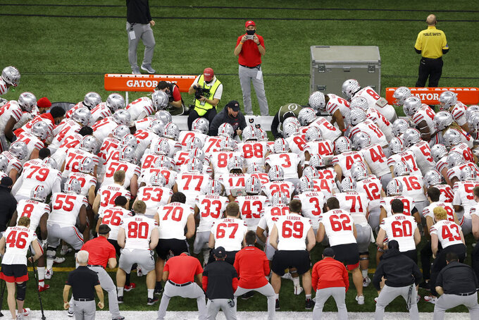 Ohio State gathers before the Sugar Bowl NCAA college football game against Clemson Friday, Jan. 1, 2021, in New Orleans. (AP Photo/Butch Dill)