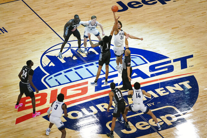 Villanova forward Jeremiah Robinson-Earl (24) and Georgetown forward Jamorko Pickett (1) tip off for the start of an NCAA college basketball game in the quarterfinals of the Big East conference tournament, Thursday, March 11, 2021, in New York. (AP Photo/Mary Altaffer)