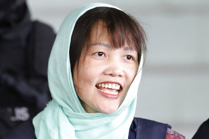 FILE - In this April 1, 2019, file photo, Vietnamese Doan Thi Huong leaves Shah Alam High Court in Shah Alam, Malaysia. A Vietnamese embassy translator says the Vietnamese woman who was tried for the killing of the estranged half brother of North Korea's leader has been released from a Malaysian prison. Maridam Yacfar told reporters at the prison Friday, May 3, 2019,  that Doan Thi Huong looked