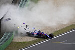 In this photo provided by Cheung Yuk Ling, Toro Rosso driver Alexander Albon of Thailand crashes his car during the third practice session for the Chinese Formula One Grand Prix at the Shanghai International Circuit in Shanghai, China, Saturday, April 13, 2019. (Cheung Yuk Ling via AP)