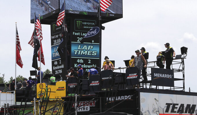Teams watch racers from the roof of their haulers during a NASCAR Cup Series auto race practice at New Hampshire Motor Speedway in Loudon, N.H., Saturday, July 20, 2019. (AP Photo/Charles Krupa)