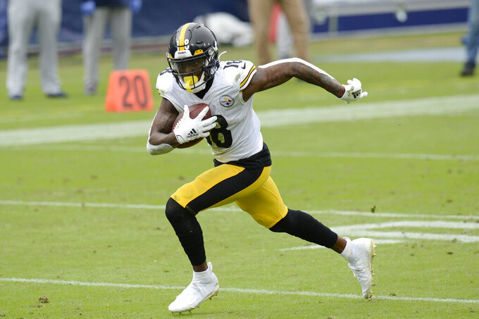 Pittsburgh Steelers wide receiver Diontae Johnson (18) scores his second touchdown of the game against the Tennessee Titans in the first half of an NFL football game Sunday, Oct. 25, 2020, in Nashville, Tenn. (AP Photo/Mark Zaleski)