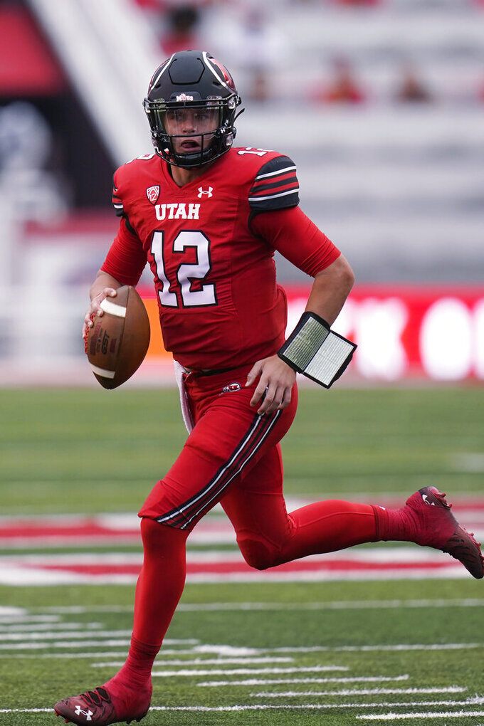 Utah quarterback Charlie Brewer runs as he looks downfield during the first half of the team's NCAA college football game against Weber State on Thursday, Sept. 2, 2021, in Salt Lake City. (AP Photo/Rick Bowmer)