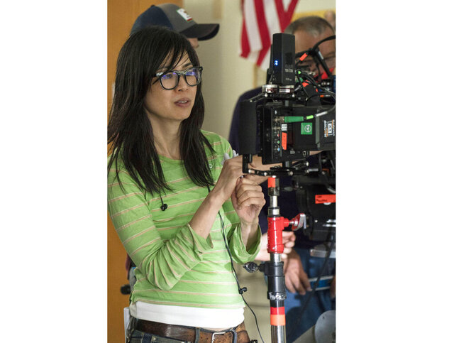 This image released by Netflix shows director Alice Wu on the set of