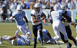 Georgia Tech's Tobias Oliver (8) runs the ball while North Carolina's J.K. Britt (29) misses the tackle during the first half of an NCAA college football game in Chapel Hill, N.C., Saturday, Nov. 3, 2018. (AP Photo/Gerry Broome)