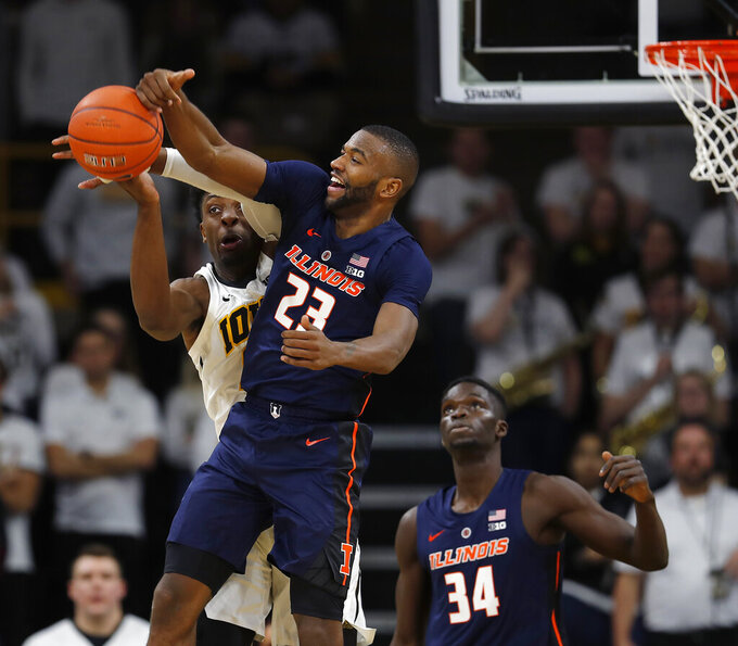 Illinois guard Aaron Jordan (23) breaks up a pass intended for Iowa forward Tyler Cook, left, during the second half of an NCAA college basketball game, Sunday, Jan. 20, 2019, in Iowa City. (AP Photo/Matthew Putney)