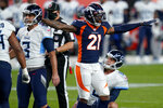 Denver Broncos cornerback A.J. Bouye (21) signals a missed field goal as Tennessee Titans kicker Stephen Gostkowski (3) watches the ball miss the uprights during the first half of an NFL football game, Monday, Sept. 14, 2020, in Denver. (AP Photo/Jack Dempsey)