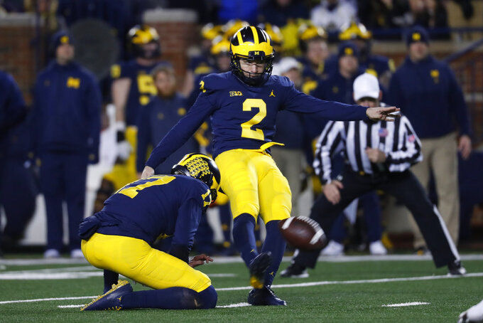 Michigan place kicker Jake Moody (2) kicks a 23-yard field goal in the second half of an NCAA college football game against Indiana in Ann Arbor, Mich., Saturday, Nov. 17, 2018. (AP Photo/Paul Sancya)