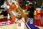 Iowa State forward Javan Johnson (13) grabs a rebound in front of Kansas State forward Carlton Linguard Jr. (12) during the first half of an NCAA college basketball game, Tuesday, Dec. 15, 2020, in Ames, Iowa. (AP Photo/Charlie Neibergall)