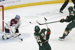Minnesota Wild's Ryan Hartman (38) shoots the puck at Colorado Avalanche's goalie Philipp Grubauer (31) during the first period of an NHL hockey game Wednesday, April 7, 2021, in St. Paul, Minn. (AP Photo/Stacy Bengs)