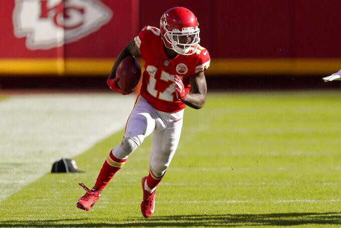 Kansas City Chiefs wide receiver Mecole Hardman (17) returns a punt in the second half of an NFL football game against the New York Jets on Sunday, Nov. 1, 2020, in Kansas City, Mo. (AP Photo/Charlie Riedel)