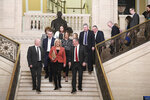 Michelle O'Neill of Sinn Fein leads her party into the chamber at Parliament Buildings, Stormont, Northern Ireland, Saturday Jan. 11, 2020. Legislators returned to Northern Ireland's assembly Saturday for the first time in three years, after a deal was struck to restore the divided region's mothballed power-sharing government. (Michael Cooper/PA via AP)