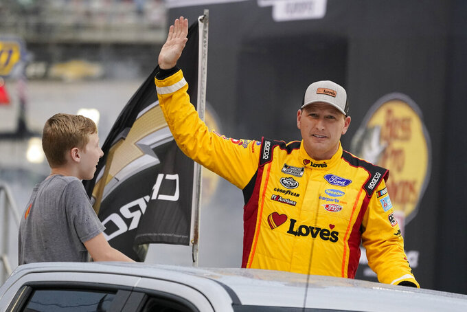 Michael McDowell waves to fans before a NASCAR Cup Series auto race at Bristol Motor Speedway Saturday, Sept. 18, 2021, in Bristol, Tenn. (AP Photo/Mark Humphrey)