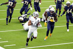 Las Vegas Raiders running back Devontae Booker (23) runs for a touchdown during the first half of an NFL football game against the Los Angeles Chargers, Sunday, Nov. 8, 2020, in Inglewood, Calif. (AP Photo/Alex Gallardo)