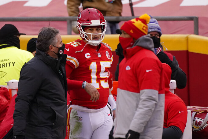 Kansas City Chiefs quarterback Patrick Mahomes (15) is helped off the field after getting injured during the second half of an NFL divisional round football game against the Cleveland Browns, Sunday, Jan. 17, 2021, in Kansas City. (AP Photo/Charlie Riedel)