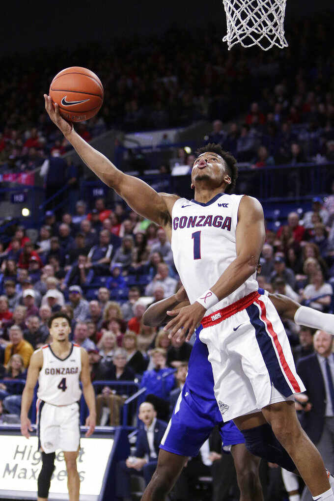 Gonzaga guard Admon Gilder (1) shoots during the first half of an NCAA college basketball game against Texas-Arlington in Spokane, Wash., Tuesday, Nov. 19, 2019. (AP Photo/Young Kwak)