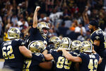 New Orleans Saints kicker Wil Lutz celebrates his game winning 58-yard field goal at the end of regulation in the second half of an NFL football game against the Houston Texans in New Orleans, Monday, Sept. 9, 2019. The Saints won 30-28. (AP Photo/Butch Dill)