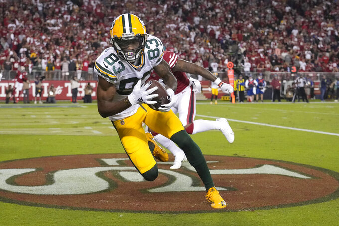 Green Bay Packers wide receiver Marquez Valdes-Scantling (83) catches a touchdown pass against the San Francisco 49ers during the second half of an NFL football game in Santa Clara, Calif., Sunday, Sept. 26, 2021. (AP Photo/Tony Avelar)