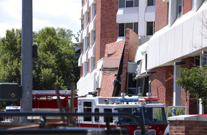 Rescue personnel respond to an explosion that damaged Argenta Hall and Nye Hall on the University of Nevada, Reno campus on Friday, July 5, 2019, in Reno, Nev. A utilities explosion Friday at the University of Nevada, Reno caused the partial collapse of a dormitory building and at least minor injuries, authorities said. (Jason Bean/The Reno Gazette-Journal via AP)