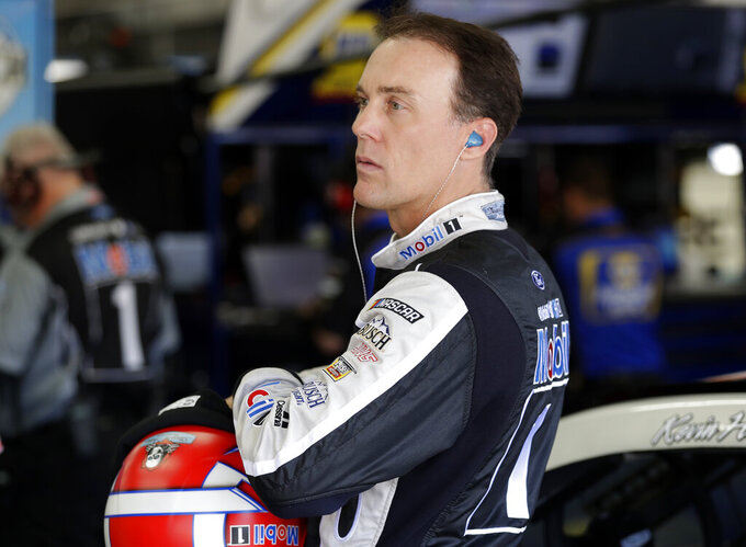 Kevin Harvick waits to climb into his car before practice for Sunday's NASCAR Cup Series auto race at Charlotte Motor Speedway in Concord, N.C., Saturday, May 25, 2019. (AP Photo/Chuck Burton)