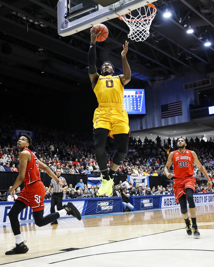 Arizona State's Luguentz Dort (0) shoots as St. John's LJ Figueroa (30) watches during the first half of a First Four game of the NCAA men's college basketball tournament Wednesday, March 20, 2019, in Dayton, Ohio. (AP Photo/John Minchillo)