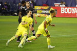 Nashville SC midfielder Hany Mukhtar, right, celebrates with Alex Muyl (29) after Mukhtar scored a goal against Inter Miami on a penalty kick during the first half of an MLS soccer playoff match Friday, Nov. 20, 2020, in Nashville, Tenn. (AP Photo/Mark Humphrey)