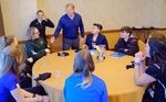 FILE - In this Feb. 26, 2019, file photo, NFL Commissioner Roger Goodell greets Saskatchewan equipment manager/team administrator Andrea Eccleston and other participants, including Bear Lake High School offensive coordinator Sam Mullet, right wearing glasses, at the NFL Women's Forum held in Indianapolis. (AP Photo/AJ Mast, File)