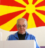A man looks at his ballot behind a voting booth at a polling station, during the presidential elections in Skopje, North Macedonia, Sunday, April 21, 2019. North Macedonia holds the first round of presidential elections on Sunday, seen as key test of the government following deep polarization after the country changed its name to end a decades-old dispute with neighboring Greece over the use of the term