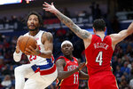 Detroit Pistons guard Derrick Rose (25) goes to the goal as New Orleans Pelicans guard JJ Redick (4) defends in the first half of an NBA basketball game in New Orleans, Monday, Dec. 9, 2019. (AP Photo/Brett Duke)