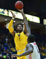 West Virginia forward Derek Culver (1) shoots over Youngstown State guard Tyler Foster (1) during the second half of an NCAA college basketball game, Saturday, Dec. 21, 2019, in Youngstown, Ohio. West Virginia won 75-64. (AP Photo/David Dermer)