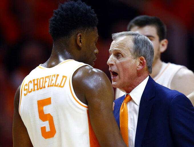 Tennessee head coach Rick Barnes talks to guard Admiral Schofield (5) after he was called for a flagrant foul in the second half of an NCAA college basketball game against West Virginia, Saturday, Jan. 26, 2019, in Knoxville, Tenn. Tennessee won 83-66. (AP Photo/Wade Payne)