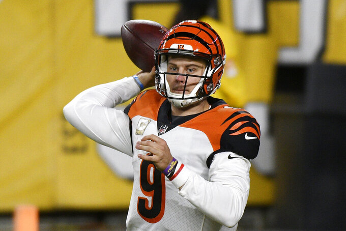 Cincinnati Bengals quarterback Joe Burrow (9) looks to throw a pass during the second half of an NFL football game against the Pittsburgh Steelers in Pittsburgh, Sunday, Nov. 15, 2020. (AP Photo/Don Wright)