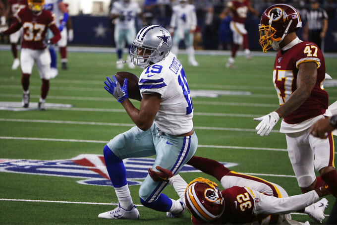 Dallas Cowboys wide receiver Amari Cooper (19) pulls down a reception over Washington Redskins cornerback Jimmy Moreland (32) to help set up a touchdown during the first half of an NFL football game in Arlington, Texas, Sunday, Dec. 15, 2019. (AP Photo/Ron Jenkins)