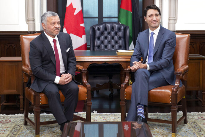King Abdullah II of Jordan, left, meets with Canadian Prime Minister Justin Trudeau on Parliament Hill in Ottawa, Ontario, Monday Nov. 18, 2019. It is King Abdullah II's fifth visit to Canada in his twenty years on the throne of the Middle Eastern country. (Adrian Wyld/The Canadian Press via AP)
